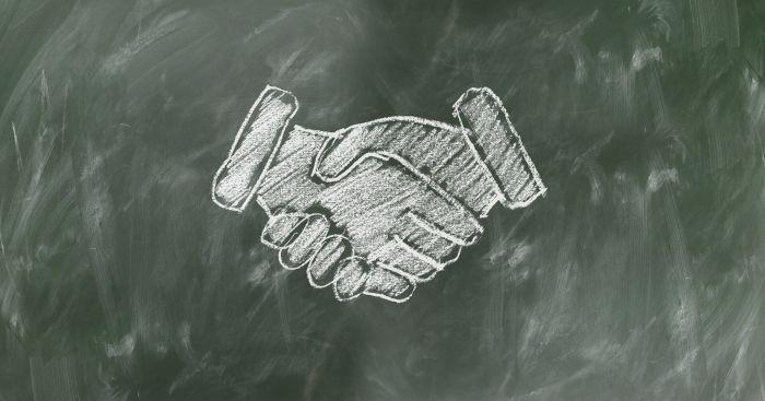 kadry - uścisk dłoni